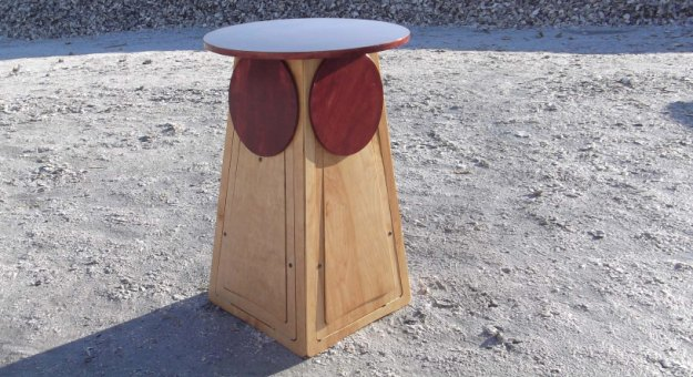 Space-Saving Seating Folds Out From Small Table
