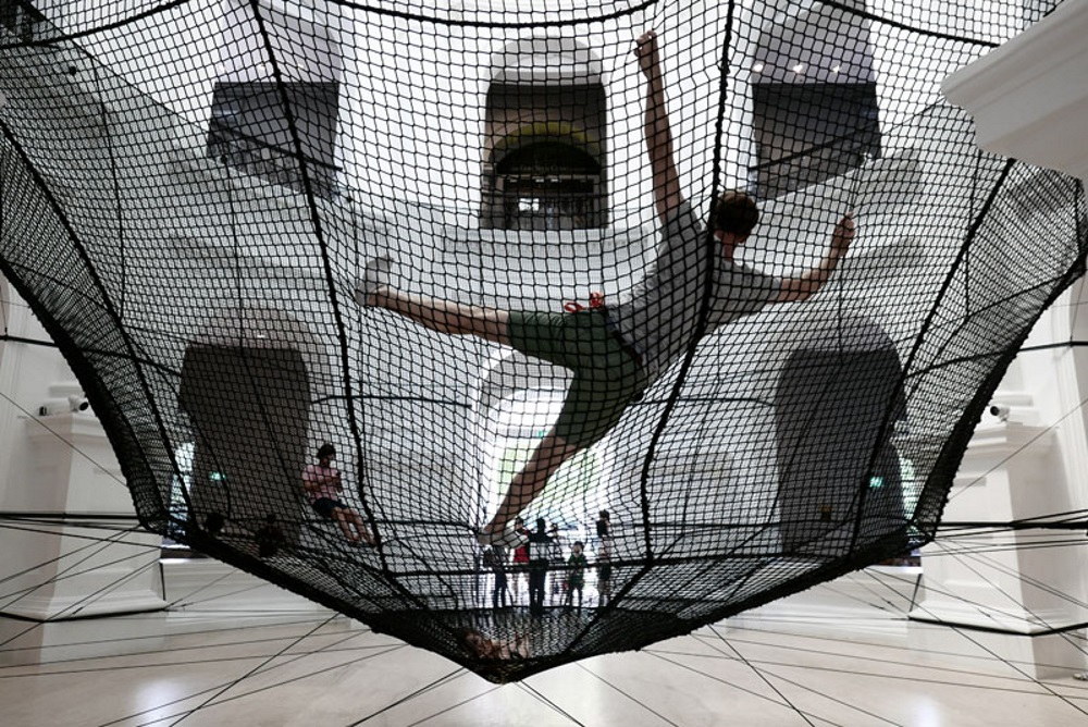 A Suspended Net Is Allowing People To Experience The National Museum Of Singapore