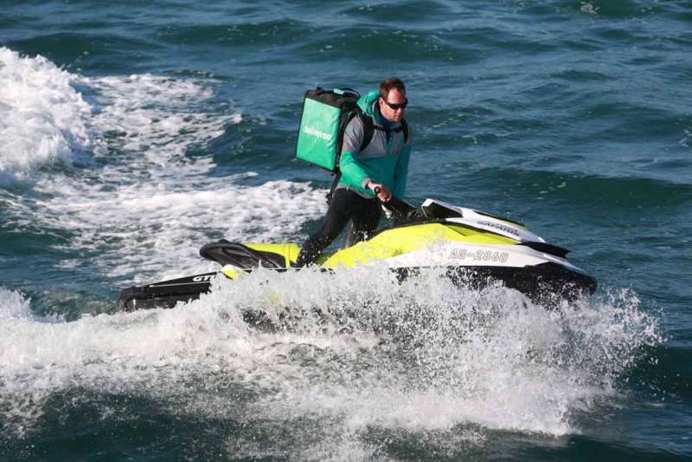Jet Ski Messengers Deliver Food Orders To Vacationers