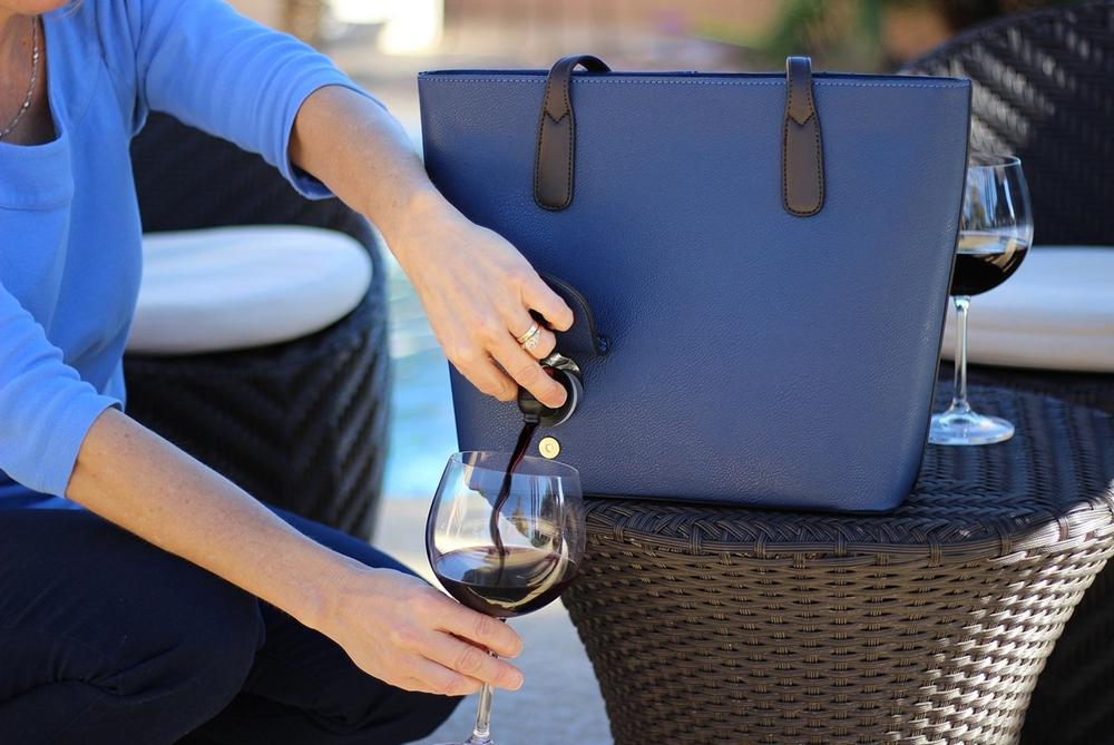 This Handbag Has A Secret Latch For Dispensing Wine