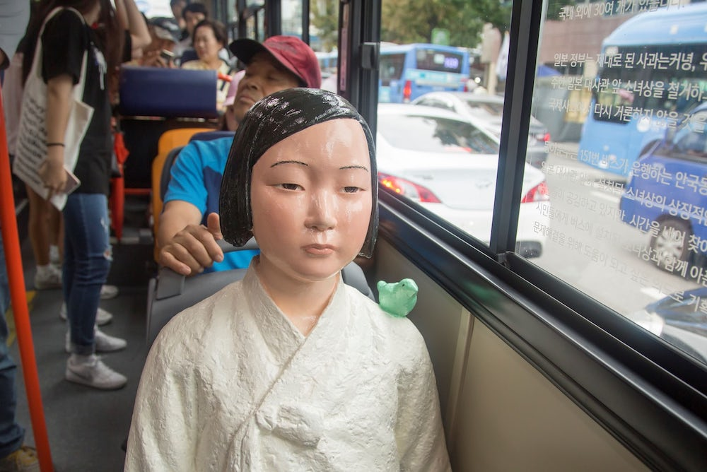 Seoul Buses Install 'Comfort Women' Statues As A Reminder Of Imperial History