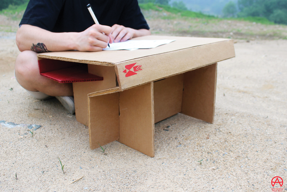 Foldable Cardboard Desk Creates An Instant Workspace For Children In Need