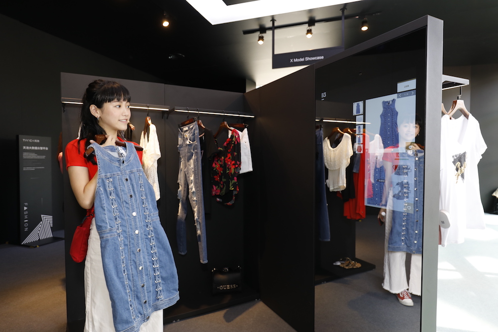 Guess' Smart Mirror Suggests Outfit Combos To Shoppers As They Try On Clothes